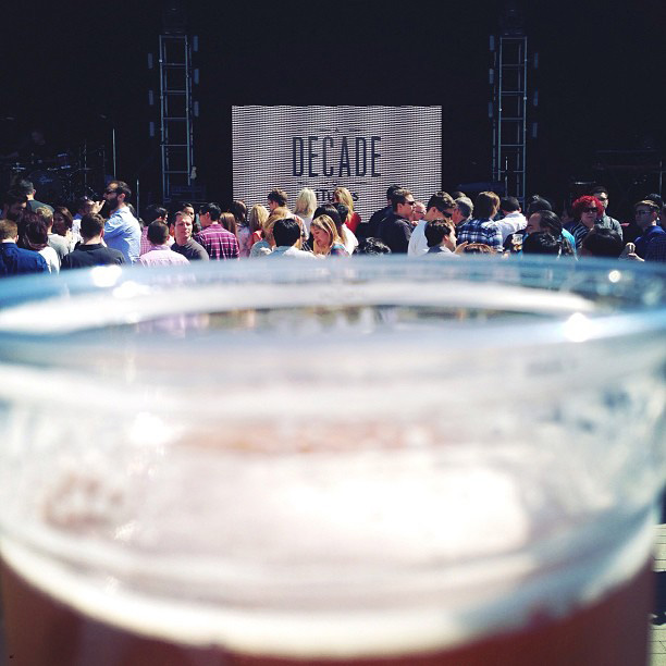 One guest's drink and a view of the stage.[Image source]