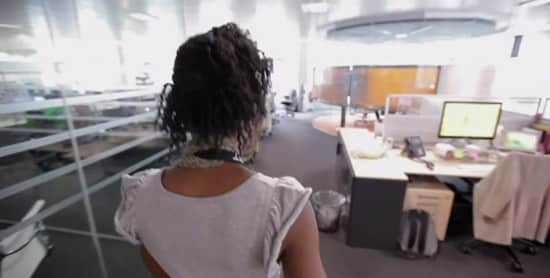 An employee walks through a large area filled with cubicles at Apple HQ