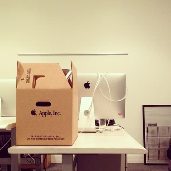 An employee moves up to a new office at Apple HQ