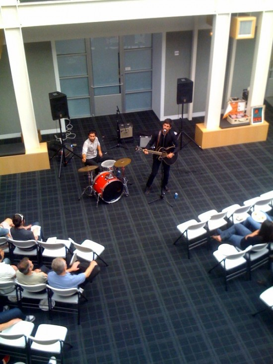 An unidentified band plays for Apple employees during their lunch break