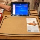 A cutting board with a built-in iPad holder.