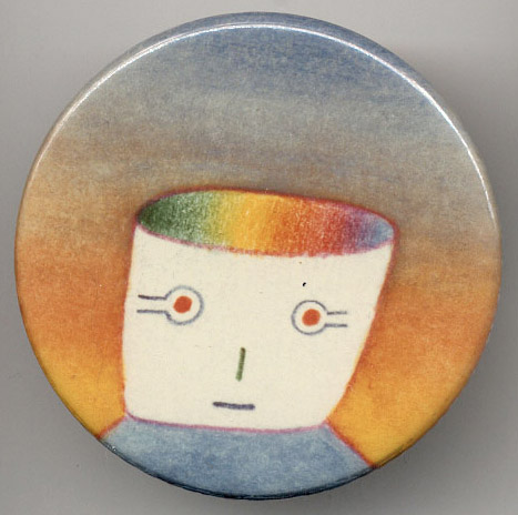 """Mister Macintosh"" pin design by Jean-Michel Folon. [Image courtesy of DigiBarn Computer Museum.]"